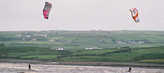 Surfs up - winds up - why not do a bit of kitesurfing